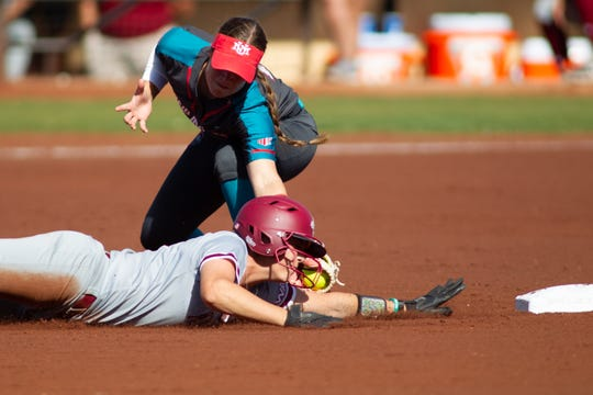 New Mexico State's Kelsey Horton beats the tag at second on Tuesday against the University of New Mexico.