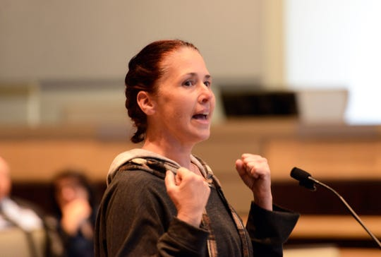 Sara Reid, mother of a skateboarder, speaks at Monday's City Council meeting about the value of skateboarding.