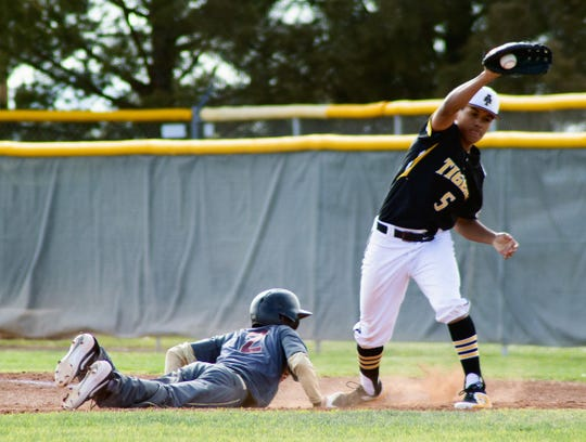 A throw from Alamogordo Tiger Michael Thatcher (14) to Elias Orozco (5) forces Gadsden Panther Beto Romero (2) to make a diving return to first base. The April 2 game would be called at the bottom of sixth inning with the Tigers winning 10-0. Alamogordo (7-7, 2-5) and Gadsden (1-9, 0-4) will face one another April 5 at 4:00 p.m. for a conference doubleheader at Gadsden.
