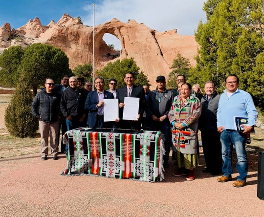 At center, Navajo Nation President Jonathan Nez and Vice President Myron Lizer were joined by tribal officials, division directors and small business owners at the proclamation signing on Tuesday in Window Rock, Ariz.