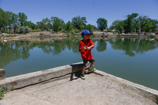 Anthony Red casts his fishing pole, May 18, 2018, at the Riverside Pond in Aztec.