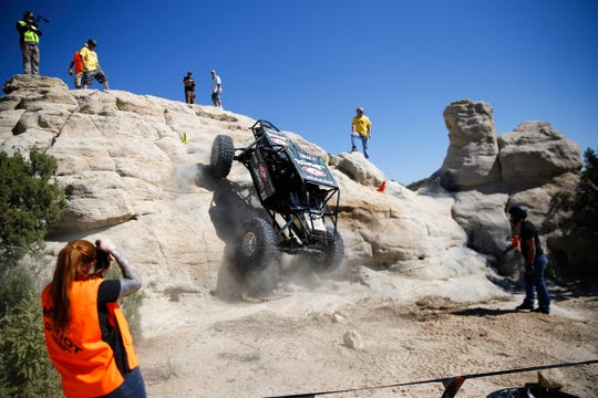 Jason Feuilly climbs his unlimited up a rock feature, Saturday, Sept. 8, 2018 during the W.E. Rock Grand Nationals at the Brown Spring Campground rock crawl in Glade Run north of Farmington.