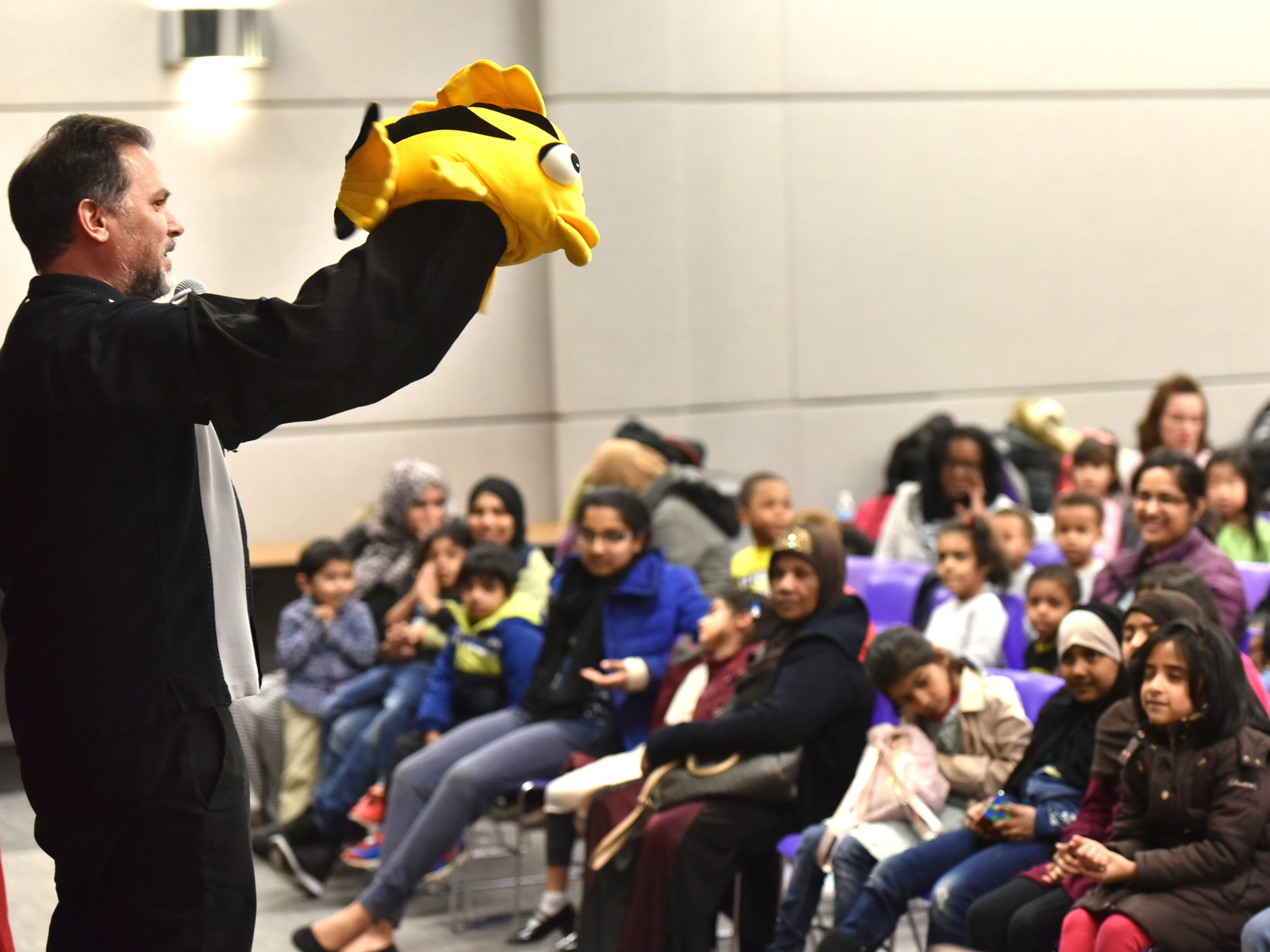 Eugene Clark introduces his audience to Jo-Jo Fish before his April 2 puppet show at the Farmington Hills Library.