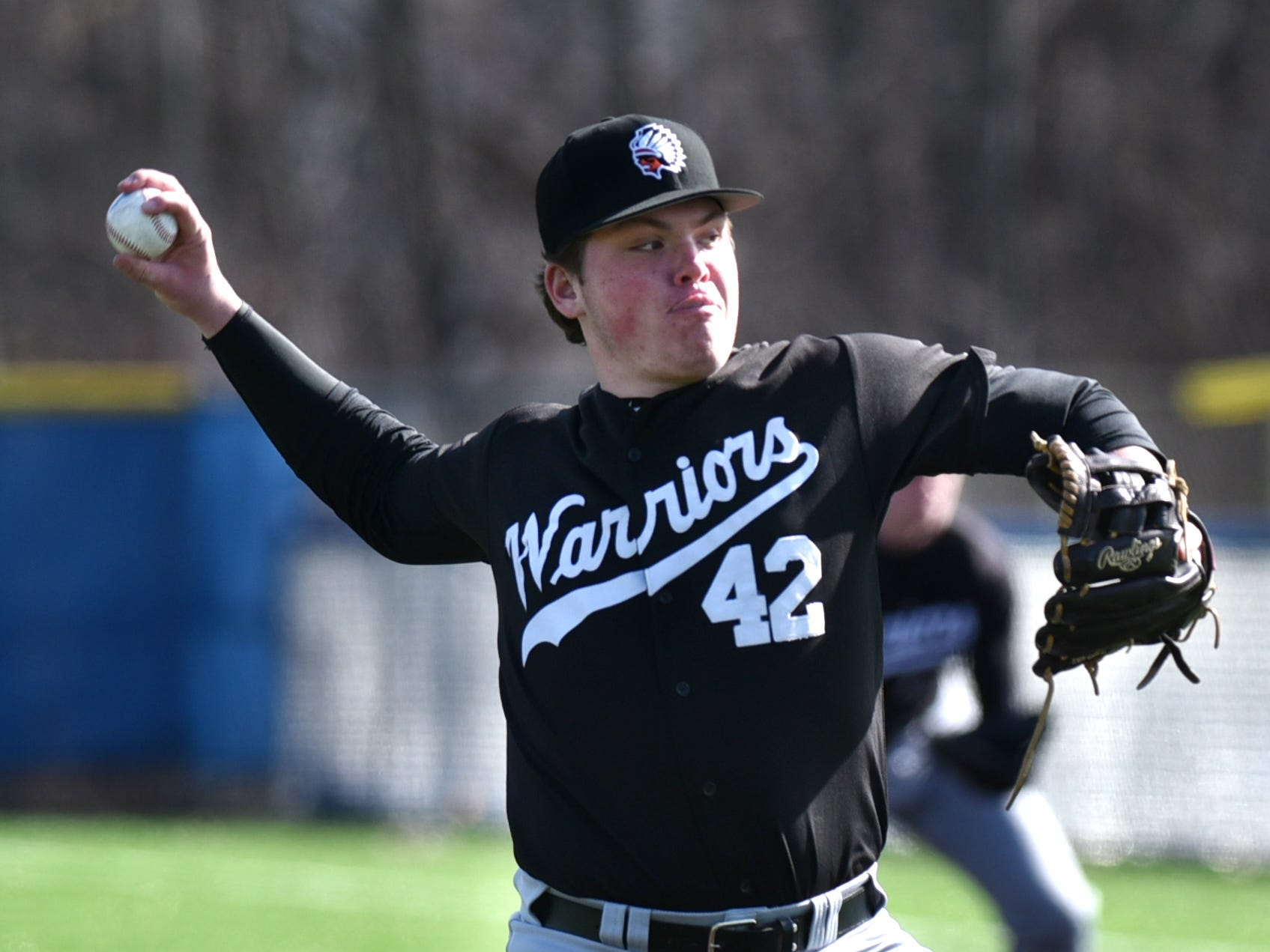 Brother Rice Warrior Tommy Maclean pitches to a Shamrock batter on April 3, 2019.