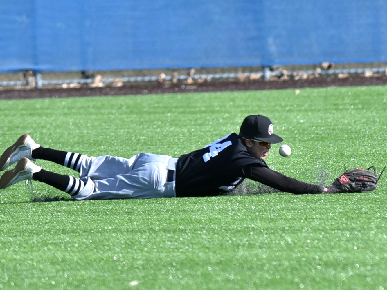 Brother Rice left fielder Shane Fuhrman dives for, but can't come up with this CC hit.