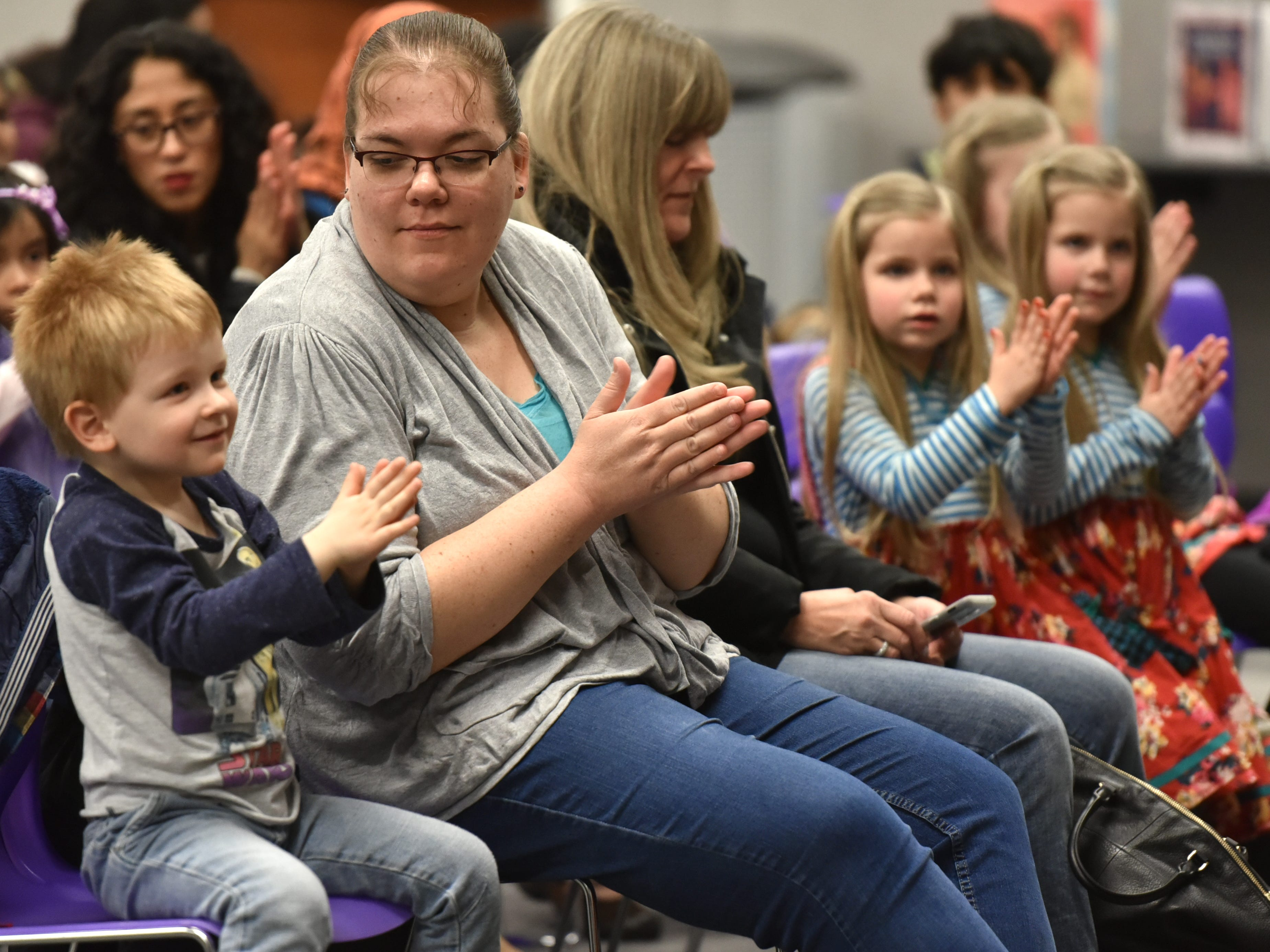 Magician and puppeteer Eugene Clark gets some applause from his audience during his April 2 visit to the Farmington Hills Library.