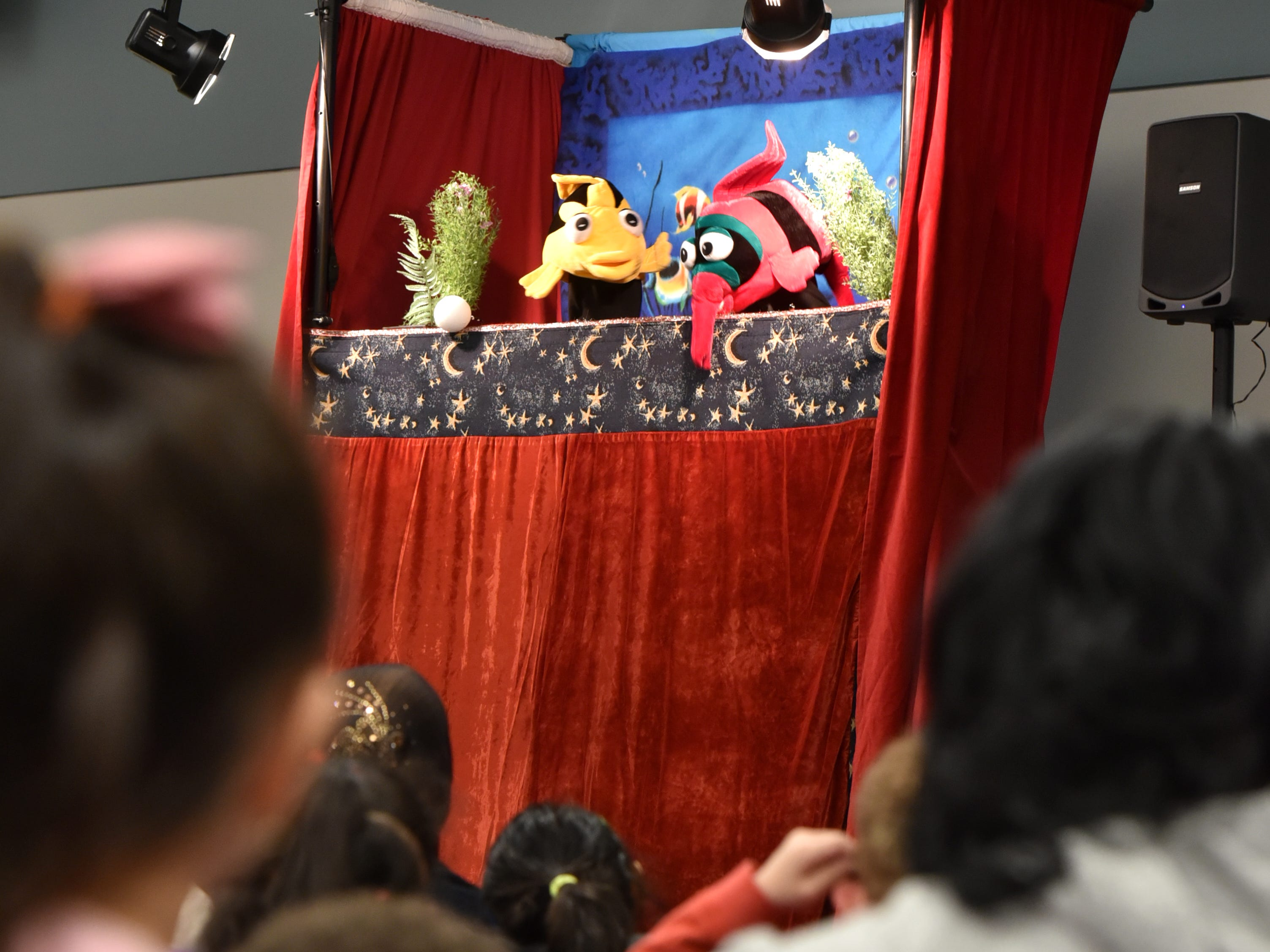 Eugene Clark begins his puppet show around 2:30 p.m. at the Farmington Hills Library on April 2.