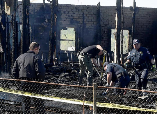 Firefighters sift through the debris that was the Greater Union Baptist Church destroyed by an early morning fire Tuesday.