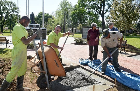 A St. Landry Parish Sheriff's Department work crew adds more memorial brick space at the St. Landry Parish Veterans Memorial.
