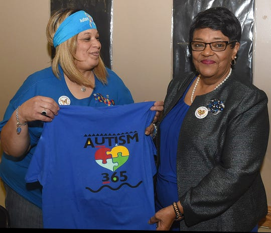 Melissa Hall, left, and St. Landry Parish Councilwoman Mildred Thierry support Autism Awareness Month during a breakfast held Tuesday at the Opelousas Civic Cejter.