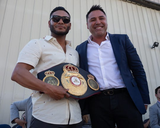 Professional boxer Andrew Cancio, shown here with promoter Oscar De La Hoya, is honored in the California-Arizona border town of Blythe on Tuesday, April 2, 2019
