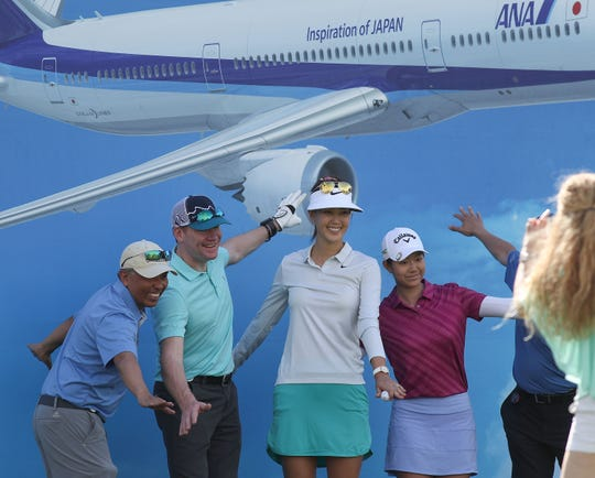 Michelle Wie takes photos with her playing partners at the ANA Inspiration pro-am at Mission Hills Country Club in Rancho Mirage, April 3, 2019.