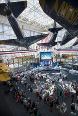 Blue Angels fans fill the atrium at the National Naval Aviation Museum seeking autographs from the famed flight demonstration squadron on Wednesday, April 3, 2019.