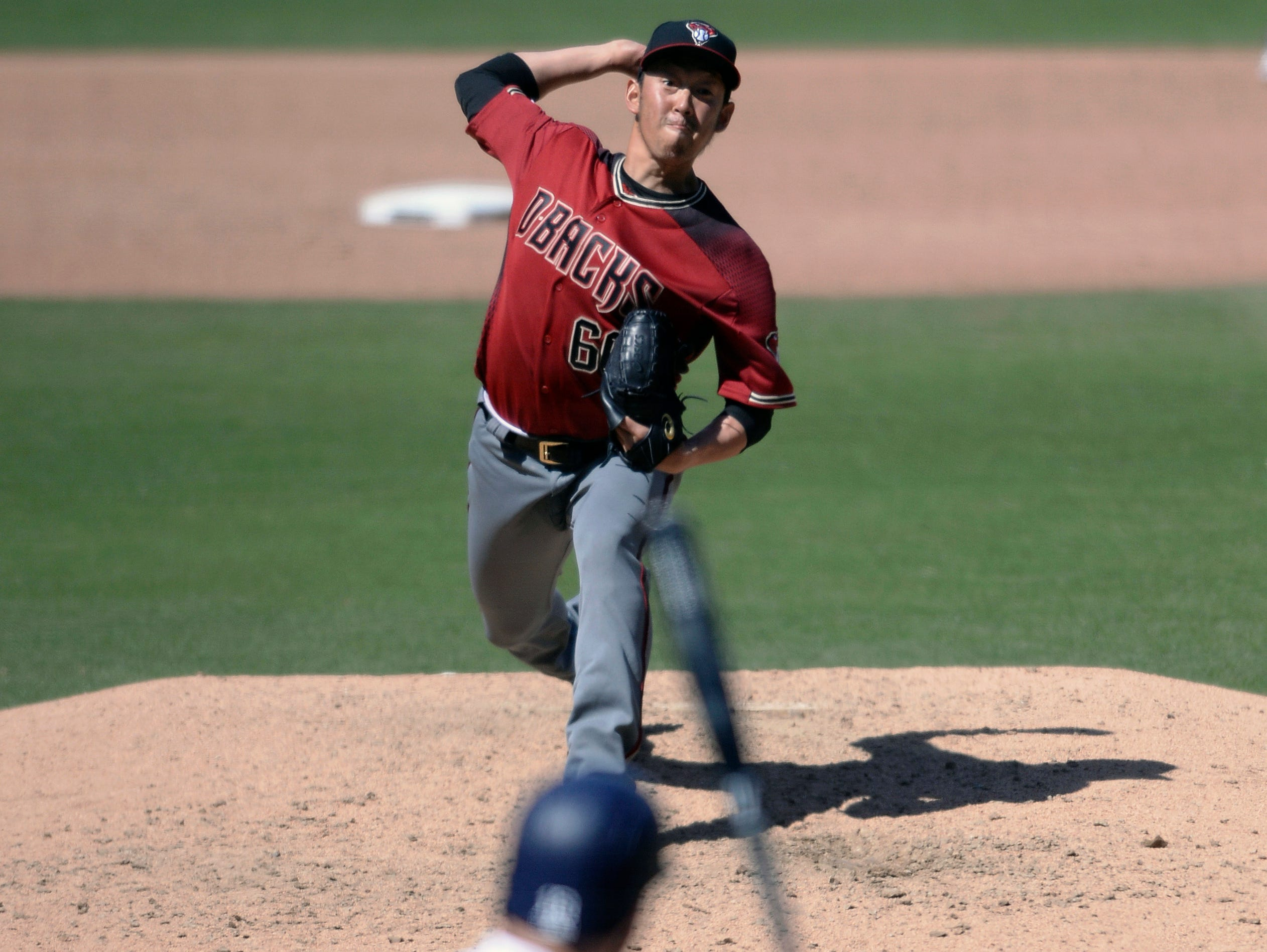 Arizona Diamondbacks relief pitcher Yoshihisa Hirano works against a San Diego Padres batter during the sixth inning of a baseball game Wednesday, April 3, 2019, in San Diego. (AP Photo/Orlando Ramirez)