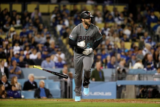 Arizona Diamondbacks' Christian Walker drops his bat after hitting a three-run home run against the Los Angeles Dodgers during the seventh inning of a baseball game Friday, March 29, 2019, in Los Angeles.