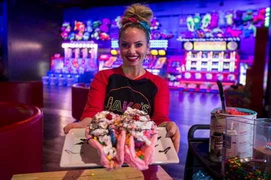 Unicorn Tacos are pictured on Monday, Apr. 1, 2019, at Jake's Unlimited in Mesa, Ariz. The dessert is made with a cotton candy shell, ice cream, cereal, sprinkles, M&M's, whipped cream, chocolate sauce, and cherries.