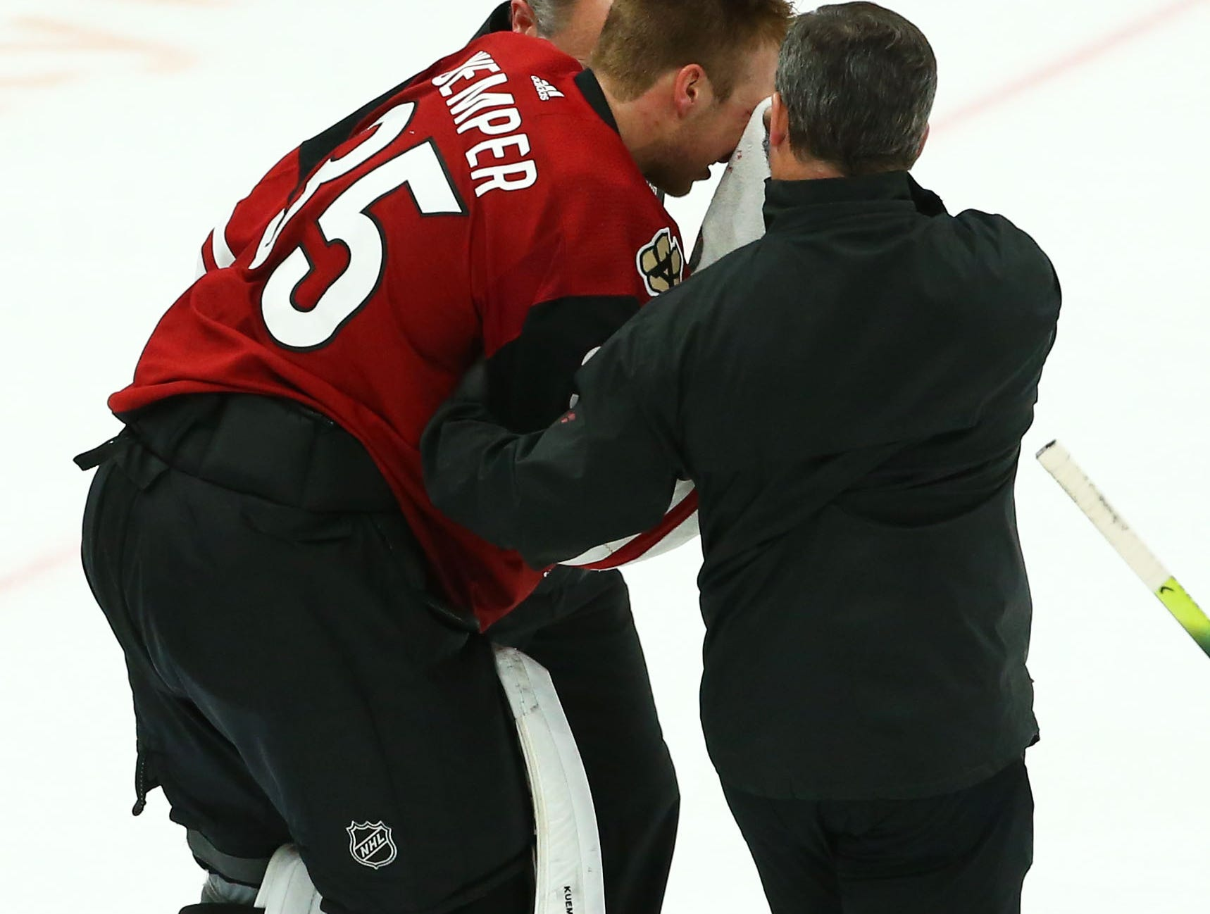 Arizona Coyotes goaltender Darcy Kuemper (35) takes a stick to the face from Los Angeles Kings center Trevor Lewis (22) after scoring a goal in the third period on Apr. 2, 2019 at Gila River Arena in Glendale, Ariz. Kuemper left the game due to this injury.