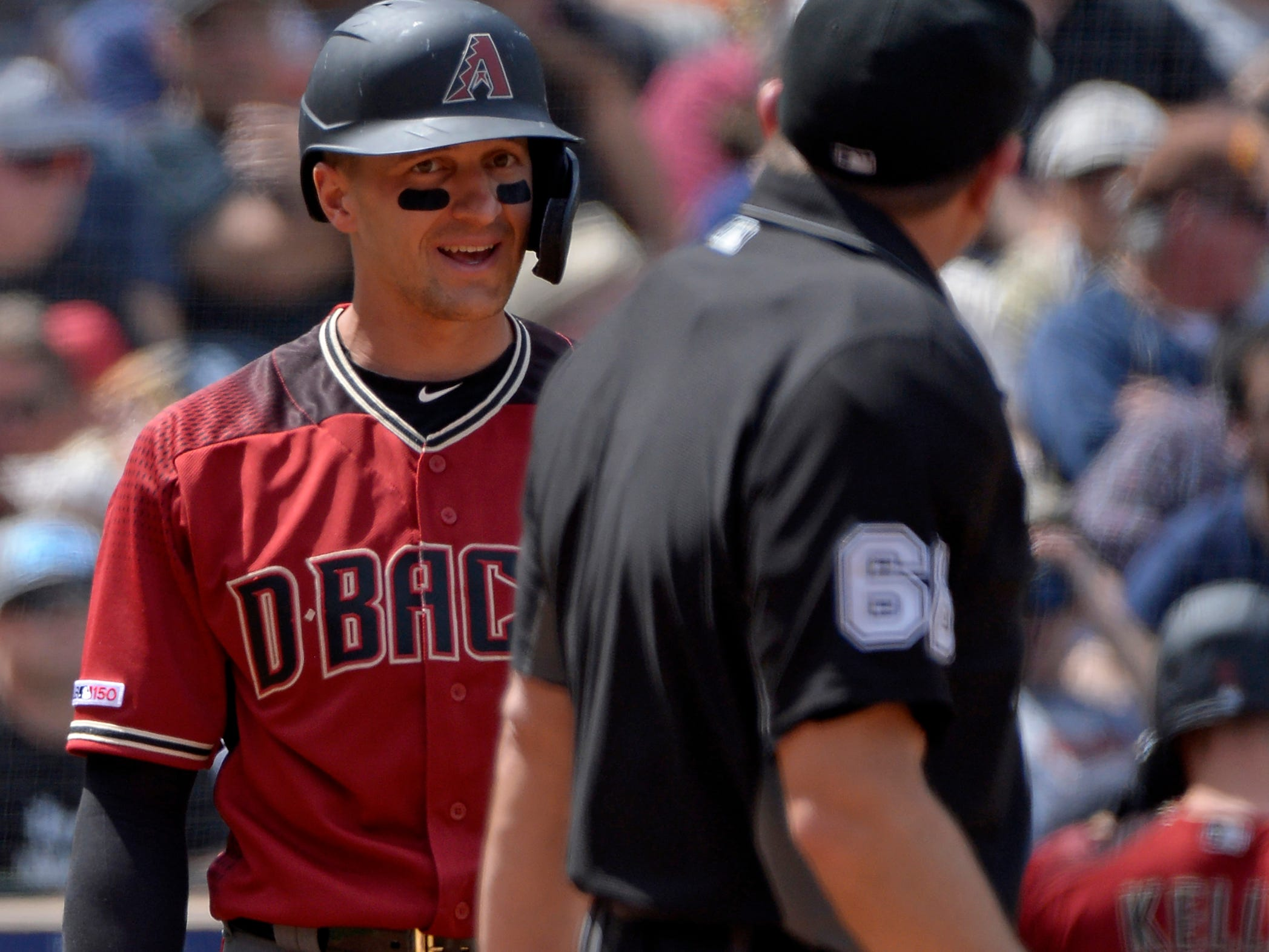 Apr 3, 2019; San Diego, CA, USA; Arizona Diamondbacks shortstop Nick Ahmed (left) argues with umpire Chris Guccione (68) after striking out in the fourth inning against the San Diego Padres at Petco Park. Mandatory Credit: Jake Roth-USA TODAY Sports