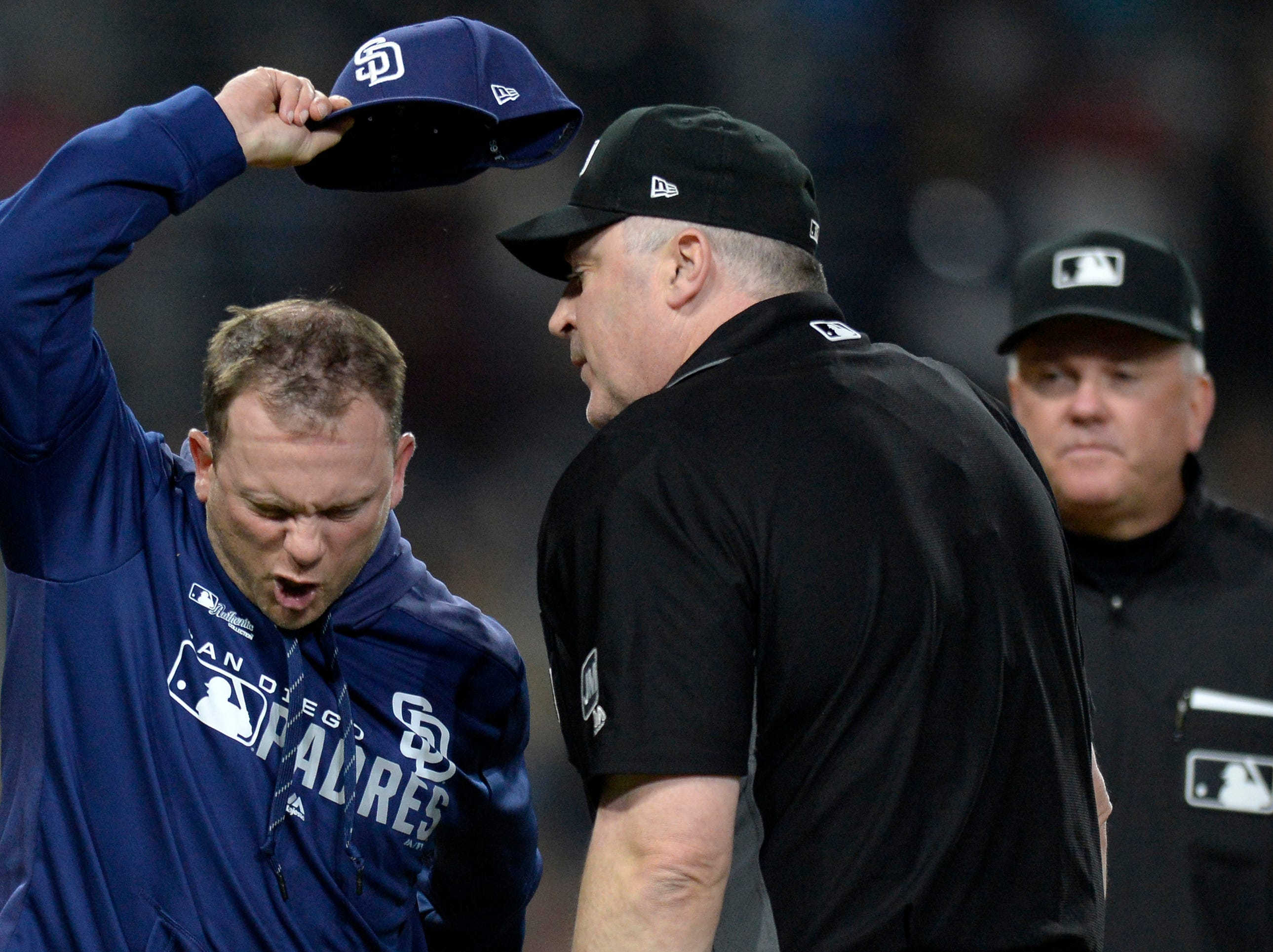 Apr 2, 2019; San Diego, CA, USA; San Diego Padres manager Andy Green (left) argues with umpire Bill Welke (center) as umpire Mike Everitt (right) looks on during the sixth inning against the Arizona Diamondbacks at Petco Park. Mandatory Credit: Jake Roth-USA TODAY Sports