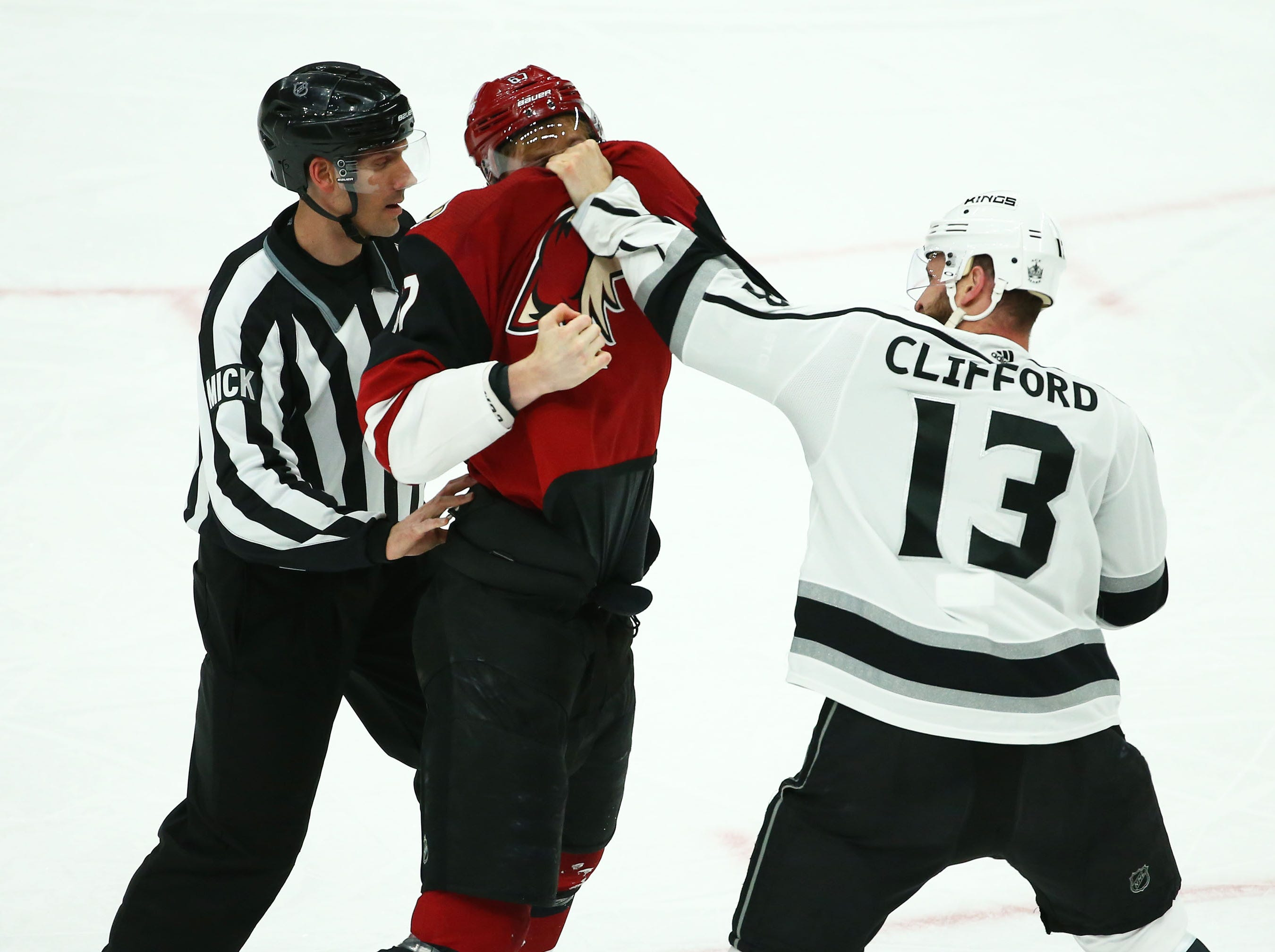 Arizona Coyotes left wing Lawson Crouse (67) fights with Los Angeles Kings left wing Kyle Clifford (13) in the first period on Apr. 2, 2019 at Gila River Arena in Glendale, Ariz.