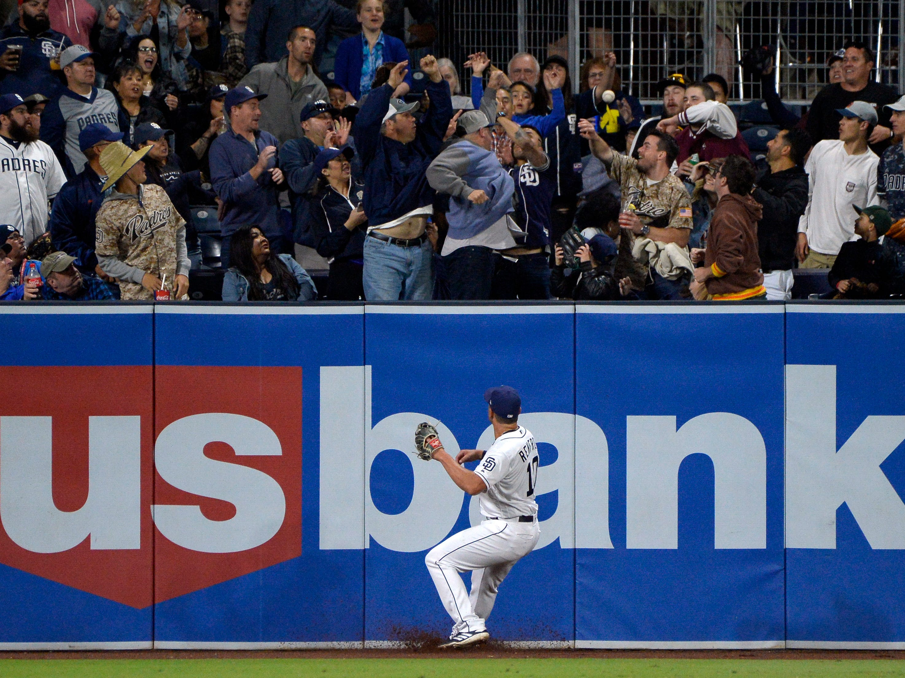 Apr 2, 2019; San Diego, CA, USA; San Diego Padres left fielder Hunter Renfroe (10) watches as fans attempt to catch a solo home run by Arizona Diamondbacks center fielder Ketel Marte (not pictured) during the fourth inning at Petco Park. Mandatory Credit: Jake Roth-USA TODAY Sports