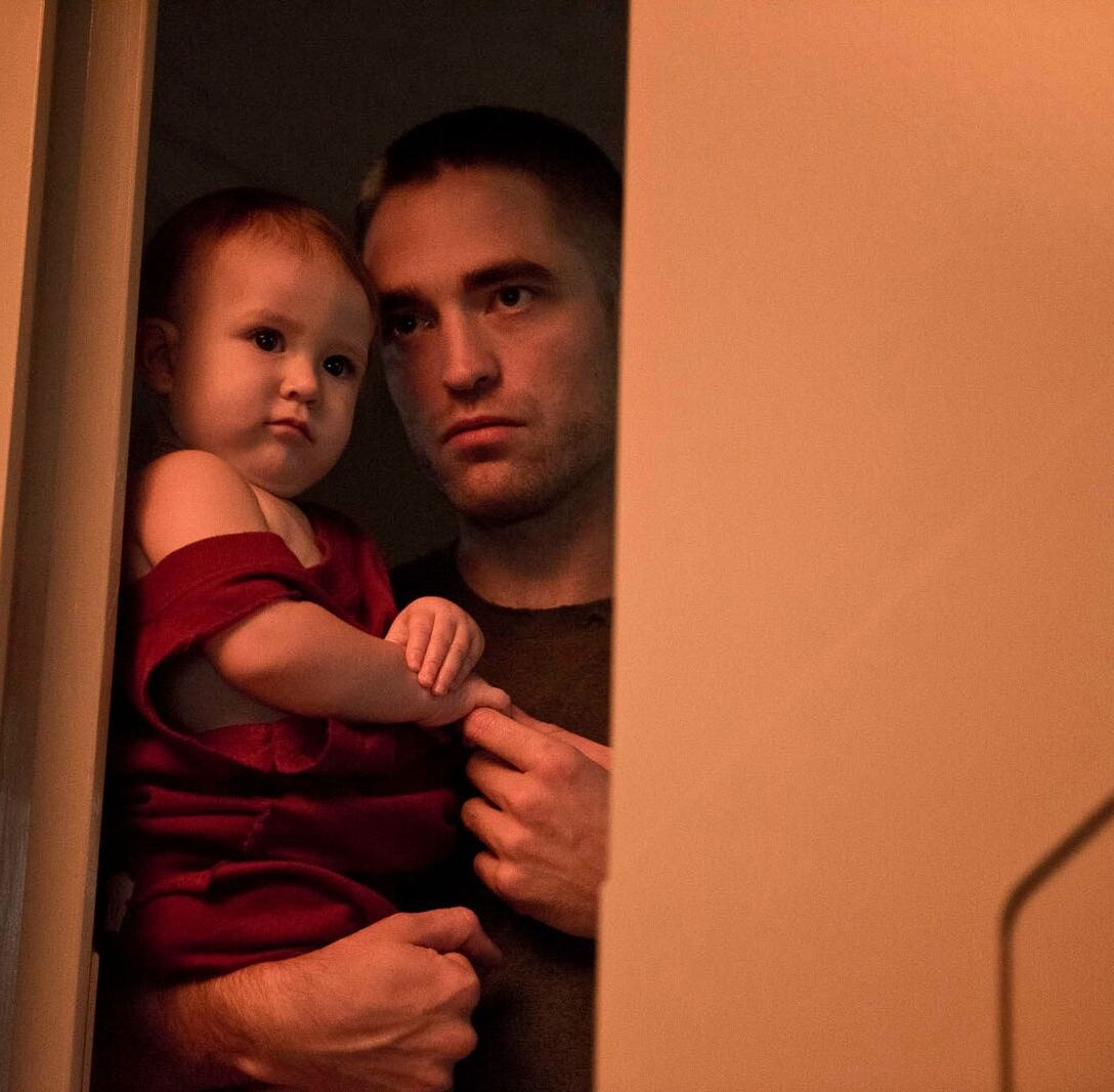 """In space horror-drama """"High Life,"""" Robert Pattinson plays Monte, a convict trapped on a space ship who unexpectedly becomes a father."""