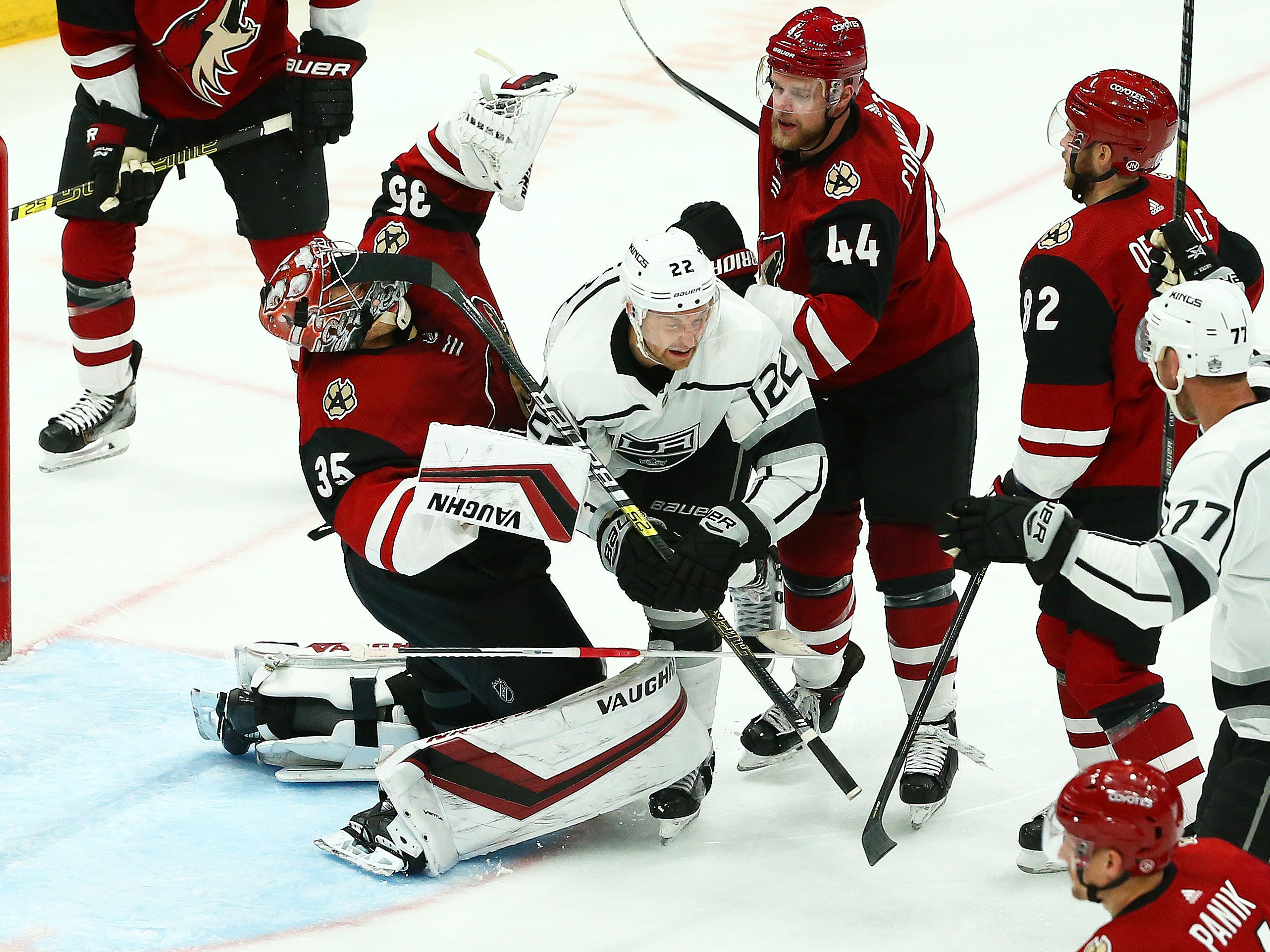 Arizona Coyotes goaltender Darcy Kuemper (35) takes a stick in the eye from Los Angeles Kings center Trevor Lewis (22) after scoring a goal in the third period on Apr. 2, 2019 at Gila River Arena in Glendale, Ariz. Kuemper left the game due to this injury.