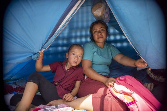Asylum-seeking families with their children staying in tents housing wait for their names to be called by CBP at the border in San Luis Rio Colorado, Mexico. Ana Landa Cenova, a single mother of two from Veracruz, Mexico, said she came to San Luis fleeing violence in her hometown.