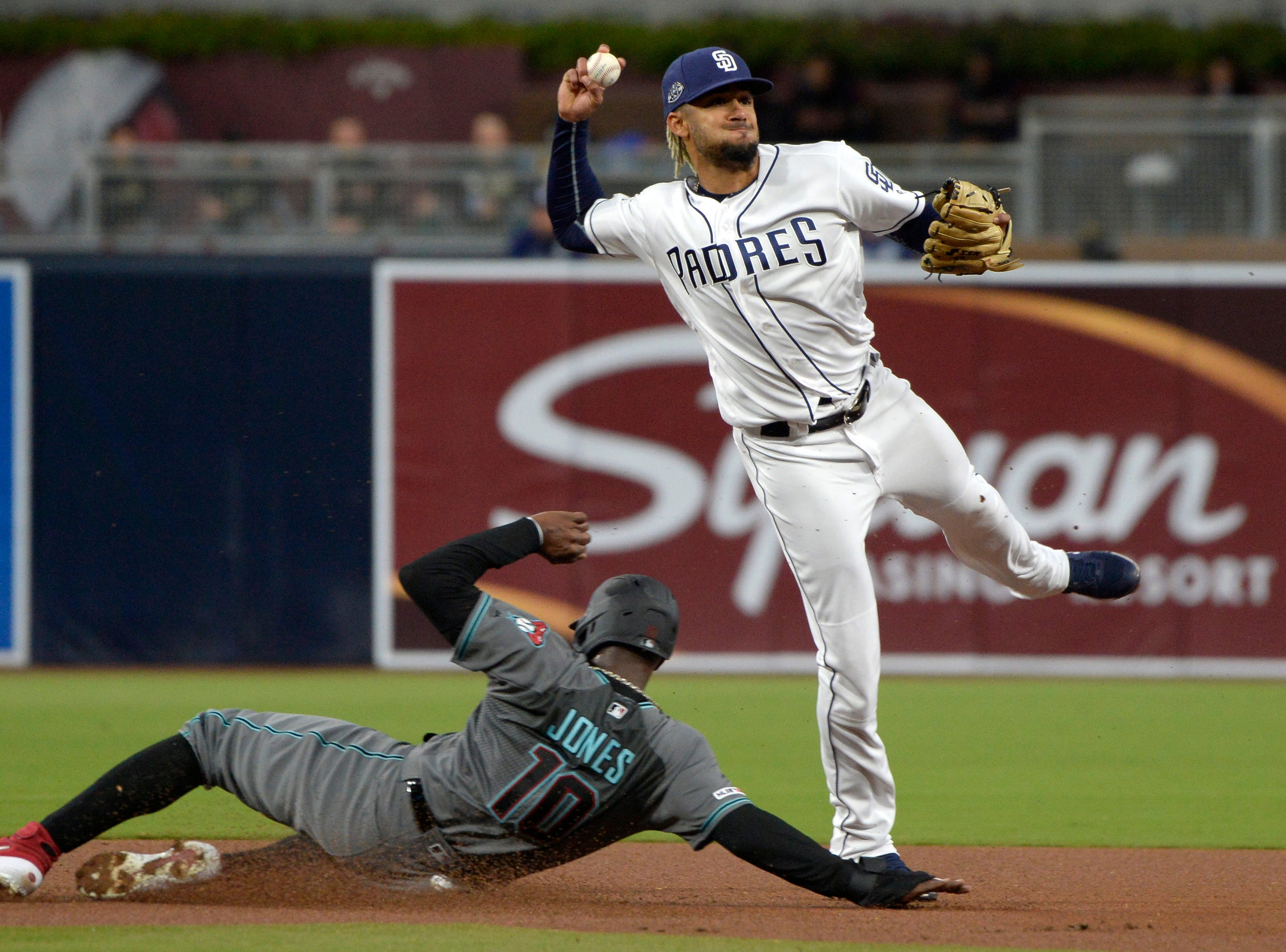 Apr 2, 2019; San Diego, CA, USA; San Diego Padres shortstop Fernando Tatis Jr. (23) throws to first base after forcing out Arizona Diamondbacks right fielder Adam Jones (10) during the first inning at Petco Park. Mandatory Credit: Jake Roth-USA TODAY Sports