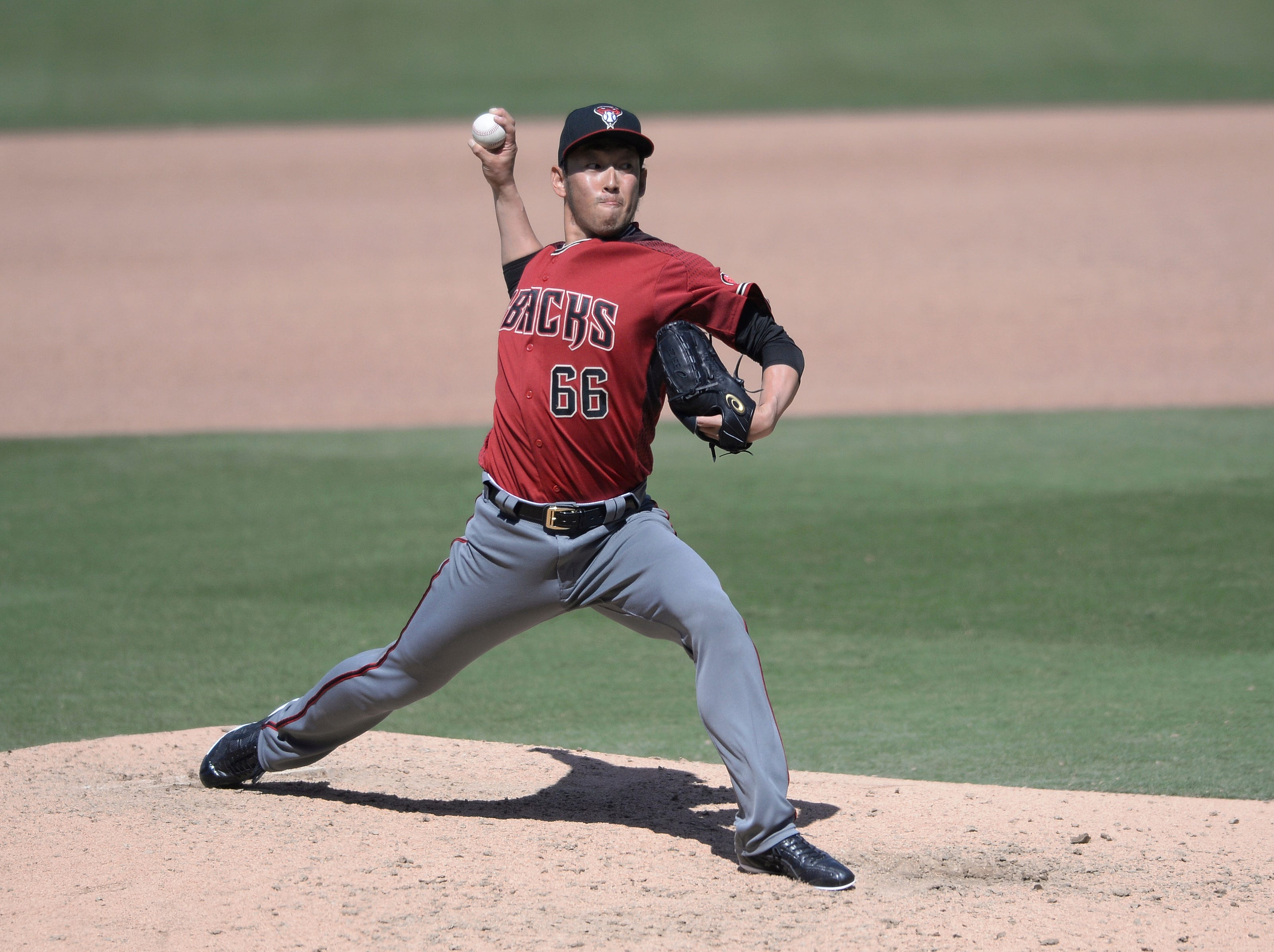 Arizona Diamondbacks relief pitcher Yoshihisa Hirano, of Japan, works against a San Diego Padres batter during the sixth inning of a baseball game Wednesday, April 3, 2019, in San Diego. (AP Photo/Orlando Ramirez)