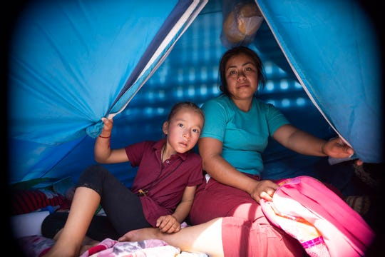 Asylum-seeking families with their children staying in tents housing waiting for their names to be called by CBP at the border in San Luis Rio Colorado, Mexico.