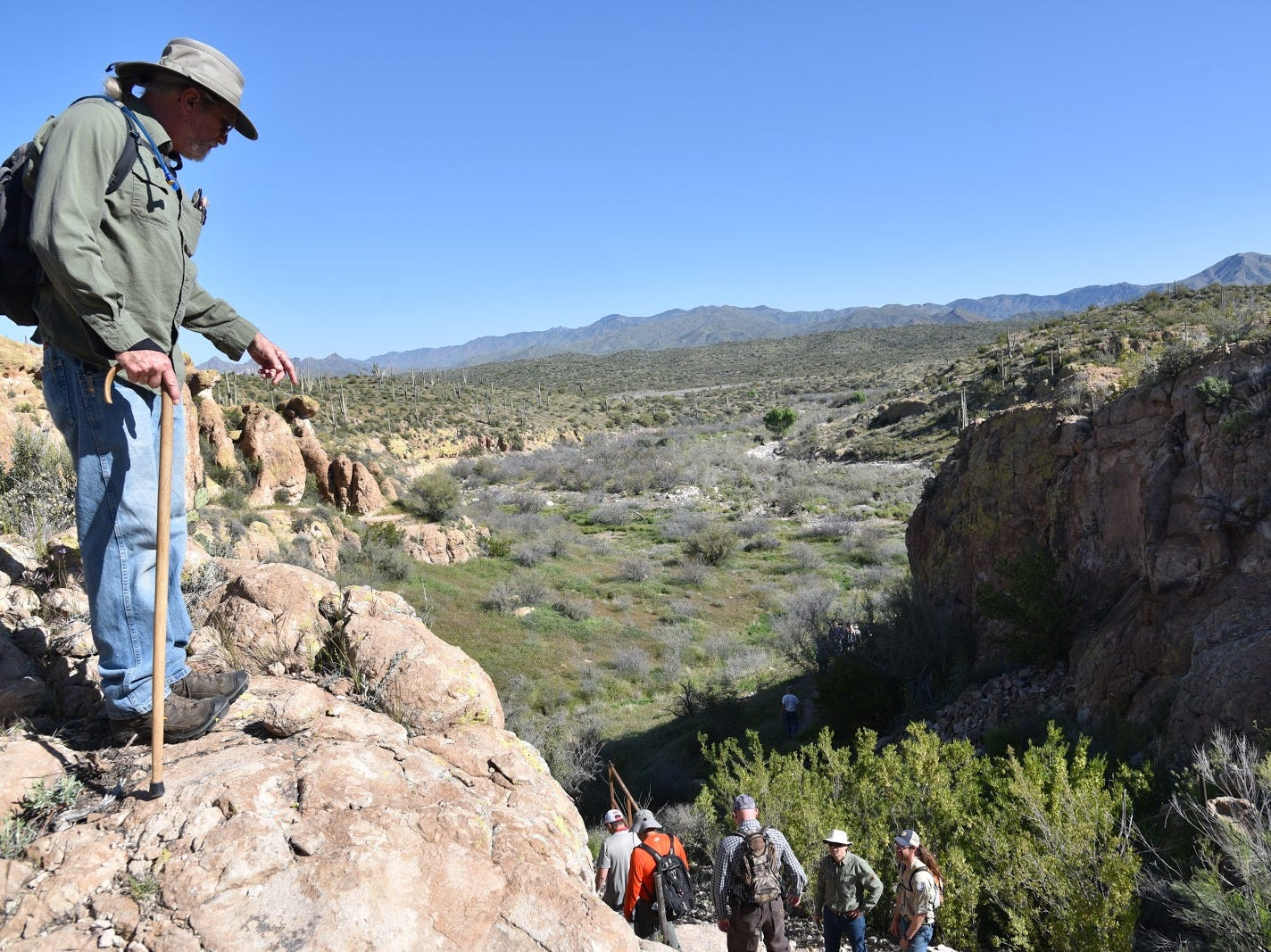 Hikers descend a steep section of the new Arnett Canyon Trail.