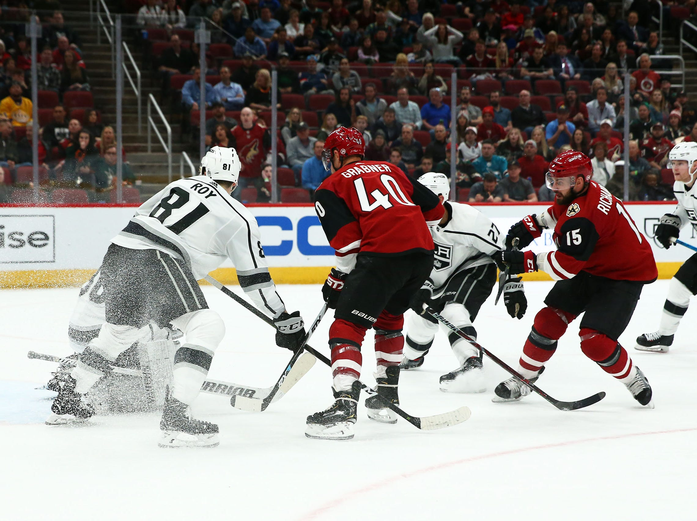Arizona Coyotes center Brad Richardson (15) scores a goal  past Los Angeles Kings goaltender Jack Campbell (36) in the second period on Apr. 2, 2019 at Gila River Arena in Glendale, Ariz.