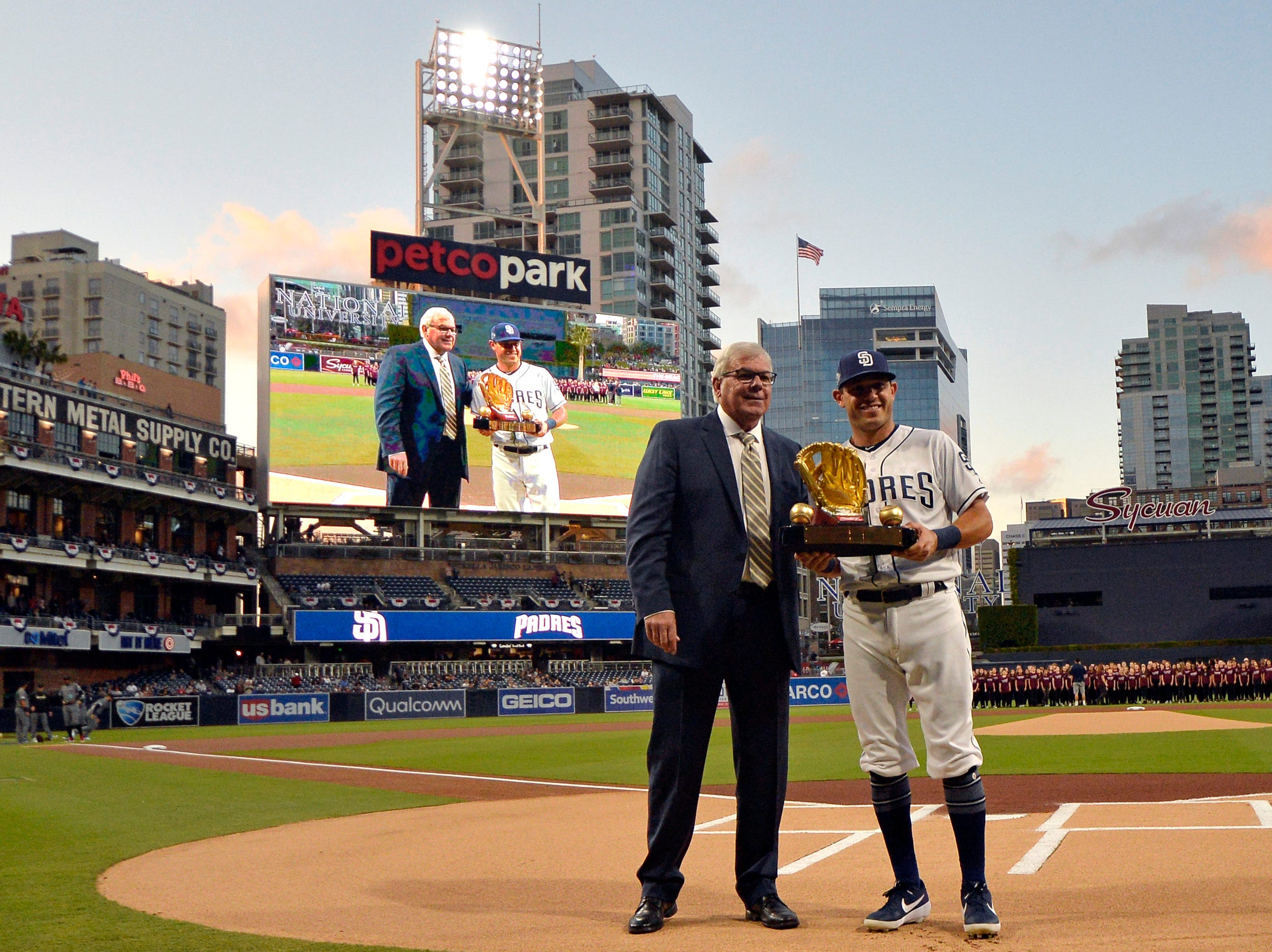 Apr 2, 2019; San Diego, CA, USA; San Diego Padres second baseman Ian Kinsler (right) is presented with his Golden Glove before a game against the Arizona Diamondbacks at Petco Park. Mandatory Credit: Jake Roth-USA TODAY Sports