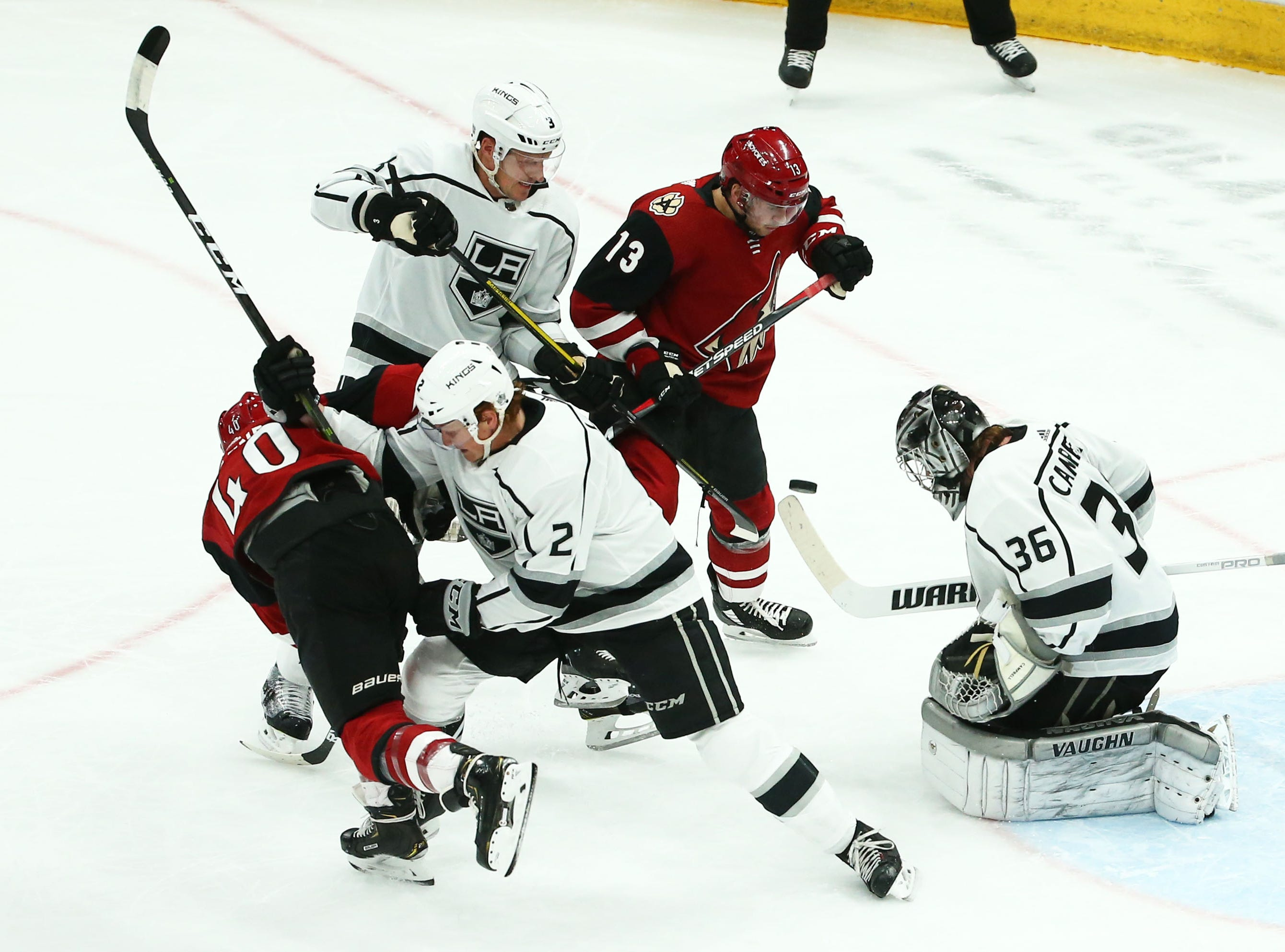 Arizona Coyotes center Vinnie Hinostroza (13) battles for the puck next to Los Angeles Kings goaltender Jack Campbell (36) in the first period on Apr. 2, 2019 at Gila River Arena in Glendale, Ariz.