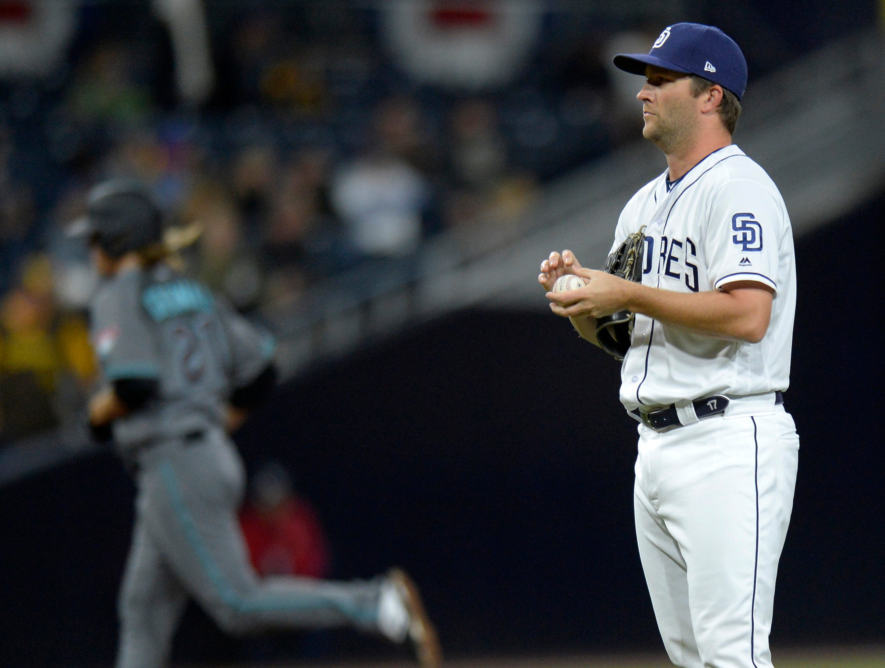 Apr 2, 2019; San Diego, CA, USA; San Diego Padres relief pitcher Adam Warren (17) reacts after giving up a solo home run to Arizona Diamondbacks starting pitcher Zack Greinke (background) during the sixth inning at Petco Park. Mandatory Credit: Jake Roth-USA TODAY Sports
