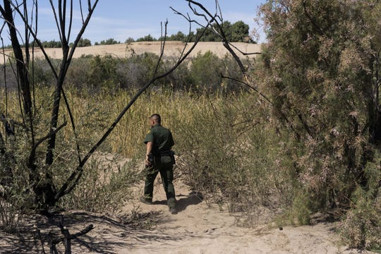 Jose Garibay, spokesman for the Border Patrol's Yuma sector, walks where migrants walk on April 2, 2019.
