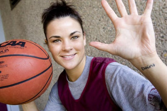 Jill Noe during her ASU women's basketball playing days (2002-08), showing her twins tattoo honoring her sister Whitney. Jill is now serving as a surrogate mother for Whitney's twins.
