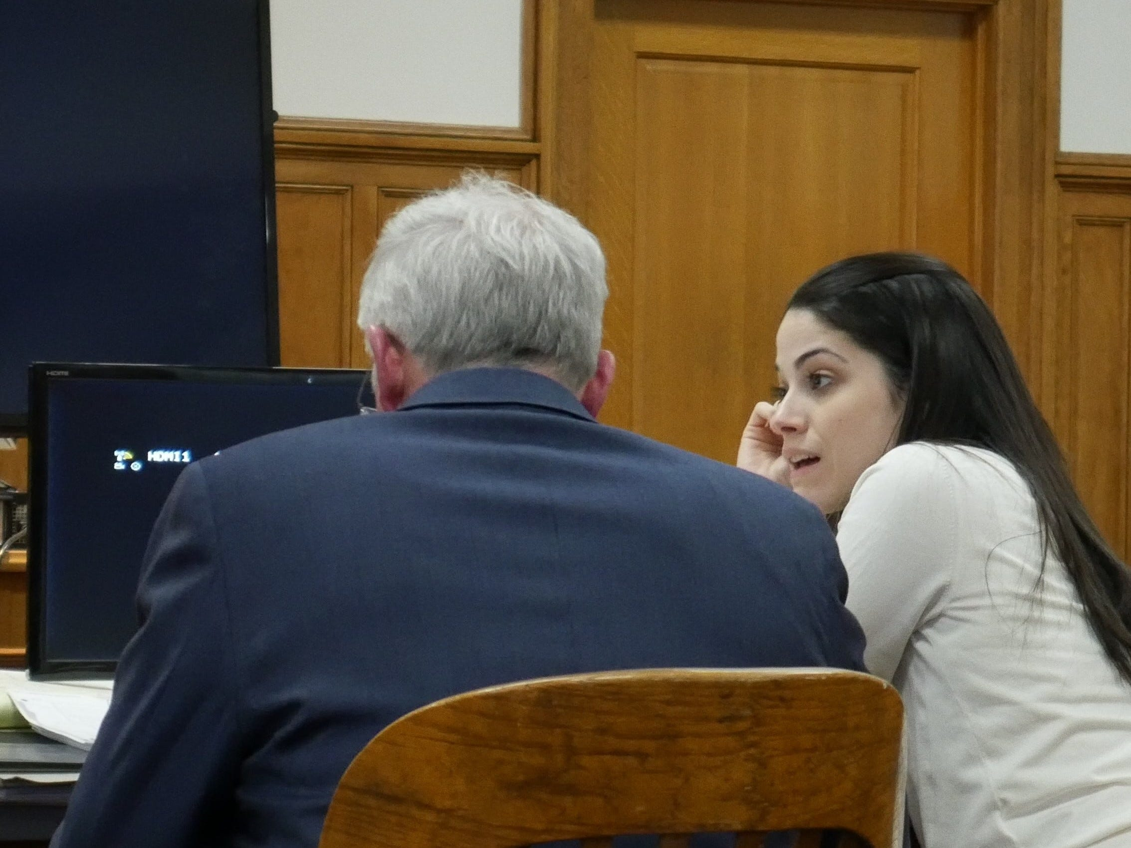 Nicole Addimando (center) speaks to one of her defense attorneys, Benjamin Ostrer, in Dutchess County Court on April 3, 2019.