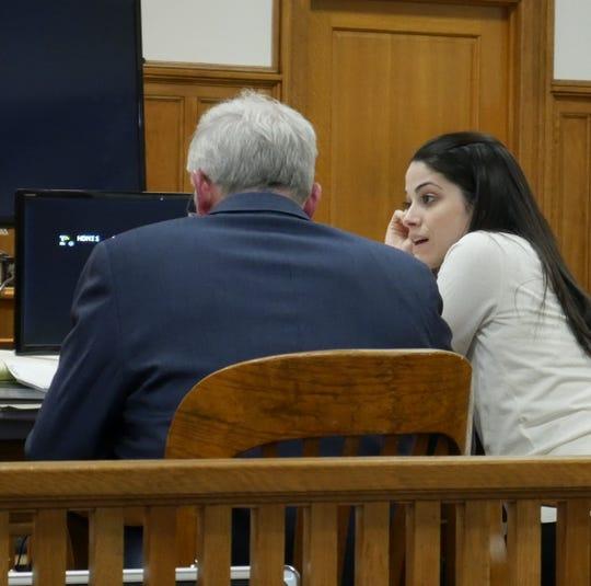Nicole Addimando (center) speaks to one of her defense attorneys, Benjamin Ostrer, in Dutchess County Court on April 3, 2019.
