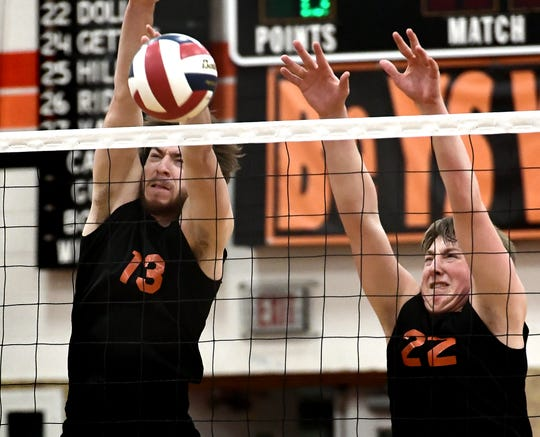 York Suburban's Nate Bowman (13) and John Doll block a shot by Central York during volleyball action at Suburban Tuesday, April 2, 2019. Central won the match 3-1. Bill Kalina photo