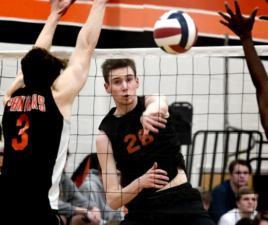 York Suburban's Declan Ridings slams a shot past Central York's Kyle Mehl (3) and Prince Gabriel, right, during volleyball action at Suburban on Tuesday, April 2. Ridings has 349 kills on the season. Bill Kalina photo