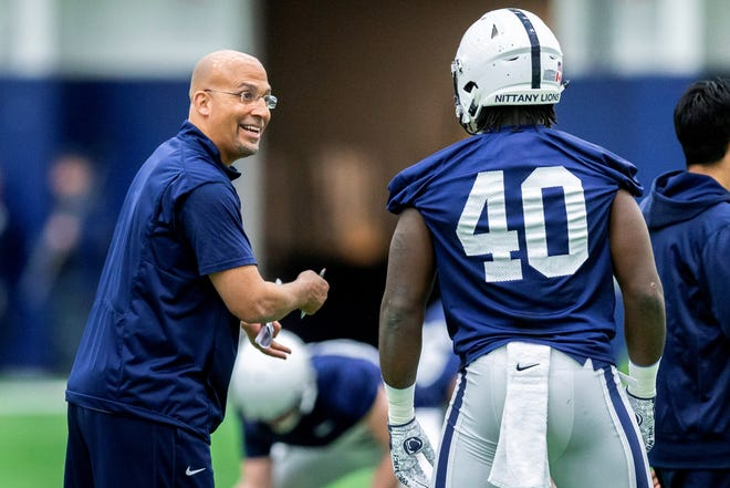 Penn State coach James Franklin jokes with linebacker Jesse Luketa during the first day of spring practice for the NCAA college football team, Wednesday, March 13, 2019, in State College, Pa. (Joe Hermitt/The Patriot-News via AP)
