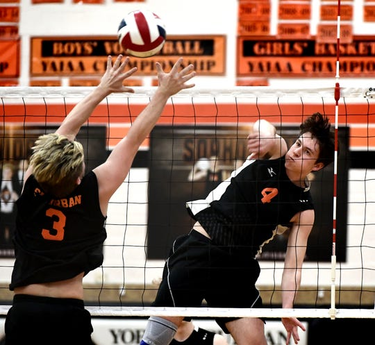 Central York's Matt Minkin slams a shot over York Suburban's Noah Chojnacki, left, during volleyball action at Suburban on Tuesday, April 2. Central, which is ranked No. 1 in the state in Class 3-A, won the match 3-1. Bill Kalina photo