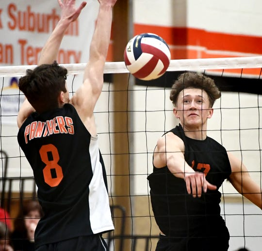 York Suburban's Harrison Perring slams a shot past Central York's Brock Anderson (8) during volleyball action at Suburban Tuesday, April 2, 2019. Central won the match 3-1. Bill Kalina photo