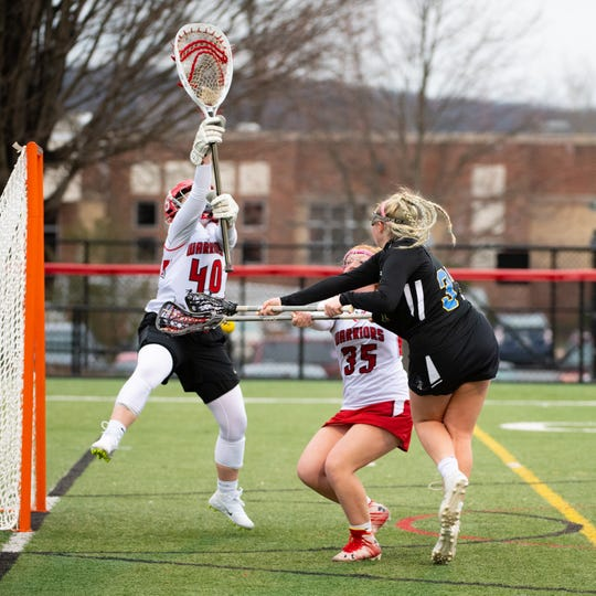 Sam McGuire (40) saves the ball during the girls' lacrosse game between Susquehannock and Kennard-Dale, April 2, 2019 at Susquehannock High School. McGuire, class of 2020, was named the 2019 YAIAA Goalie of the Year.