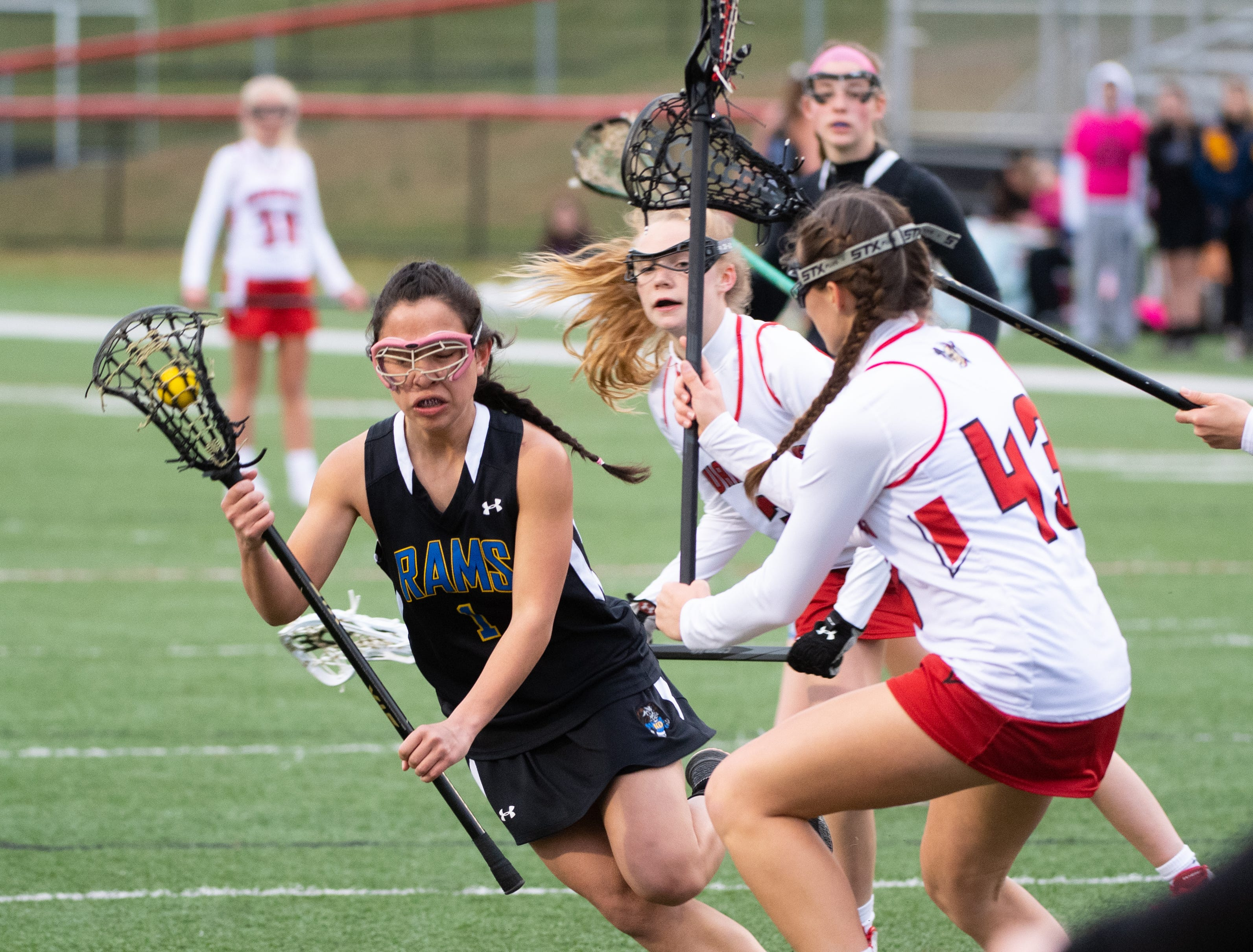 Jenna Soukaseum (1) evades the defense during the girls' lacrosse game between Susquehannock and Kennard-Dale, April 2, 2019 at Susquehannock High School. The Rams defeated the Warriors 17 to 2.