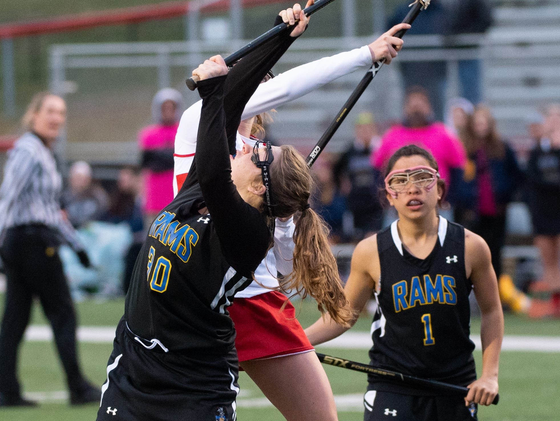 Lily Dressel (30) looks to secure the ball during the girls' lacrosse game between Susquehannock and Kennard-Dale, April 2, 2019 at Susquehannock High School. The Rams defeated the Warriors 17 to 2.