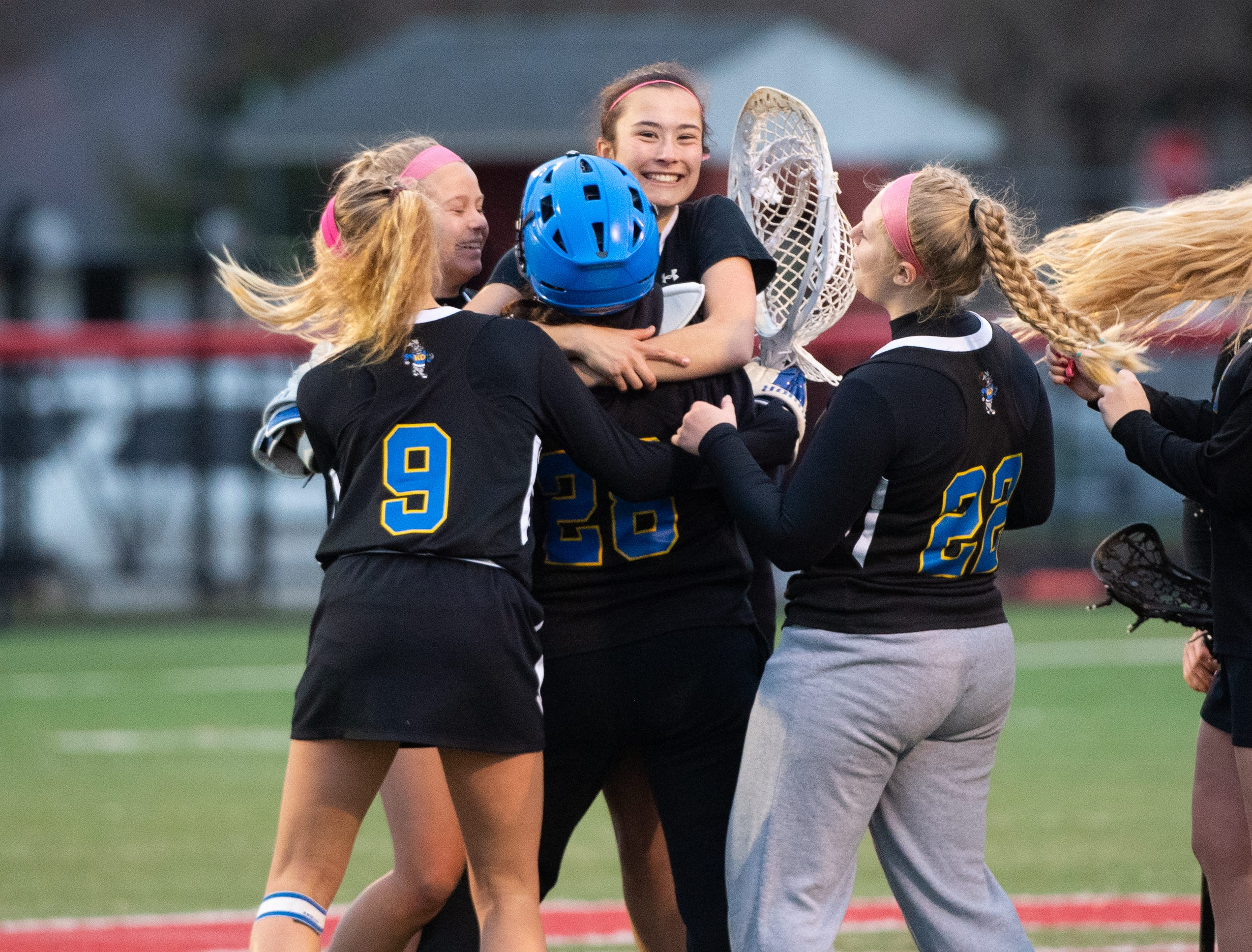 Kennard-Dale celebrates after defeating Susquehannock in a girls' lacrosse game, April 2, 2019 at Susquehannock High School. The Rams defeated the Warriors 17 to 2.