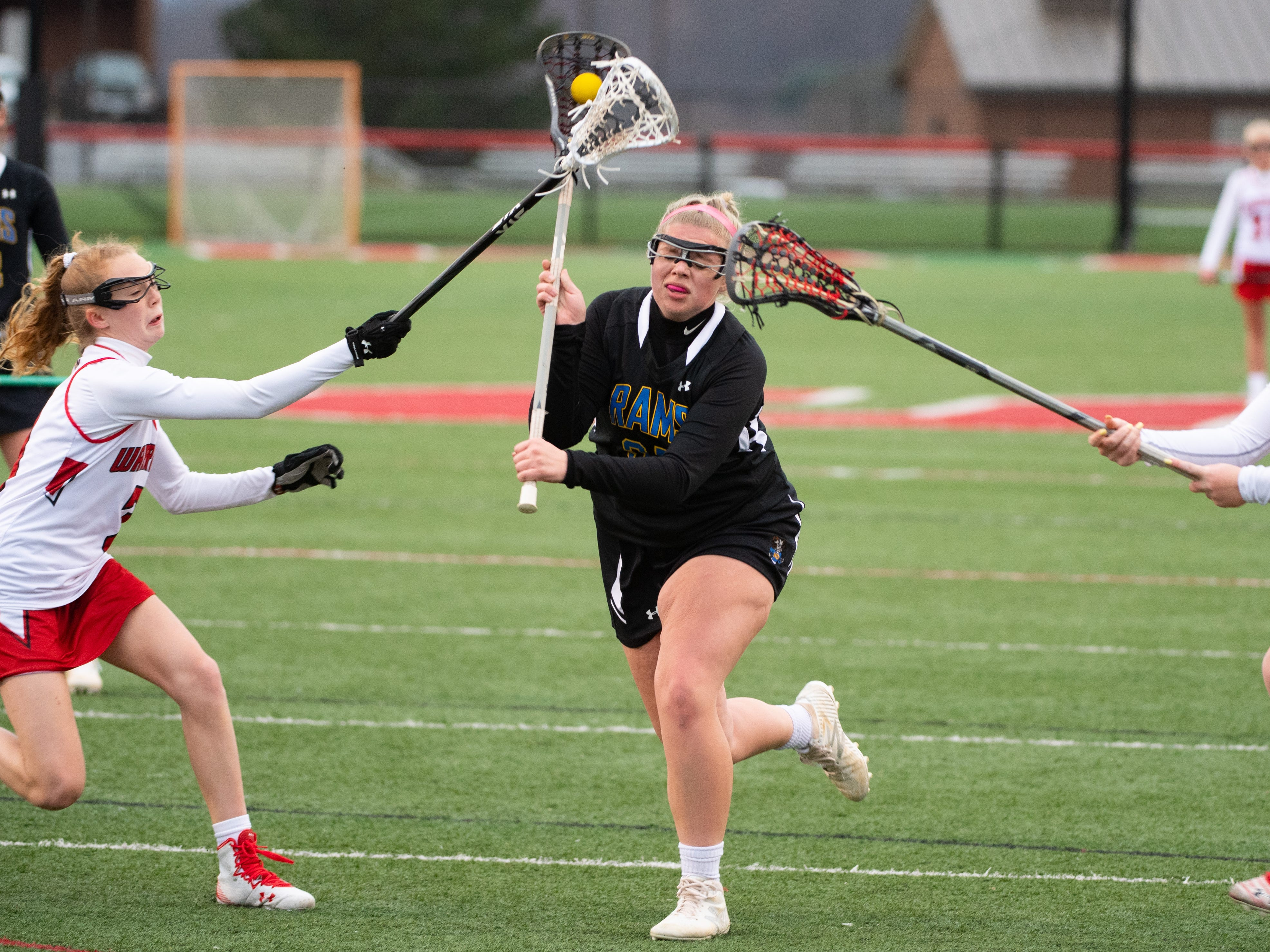 Jackie Dalton (37) tries to break through during the girls' lacrosse game between Susquehannock and Kennard-Dale, April 2, 2019 at Susquehannock High School. The Rams defeated the Warriors 17 to 2.